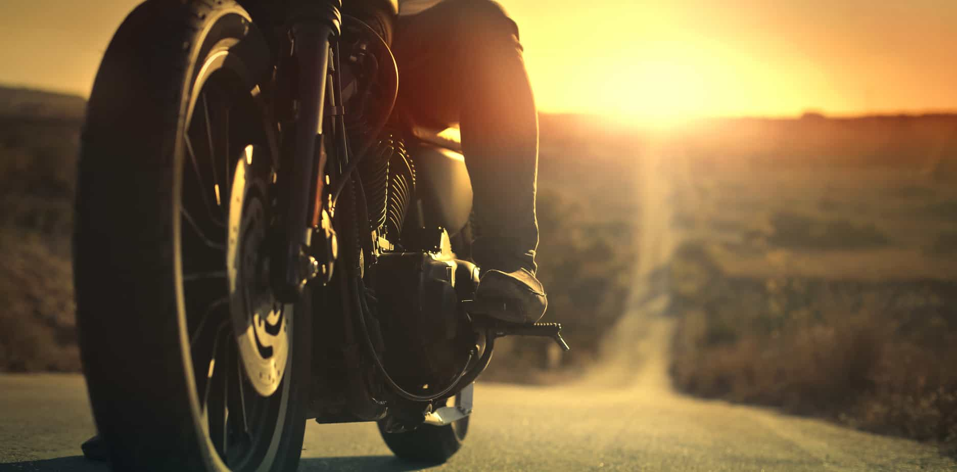 Man on motorcycle preparing to ride into the sunset