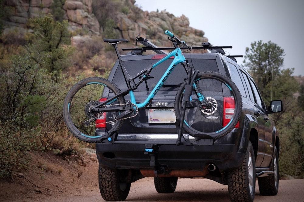 SUV with bike on rack