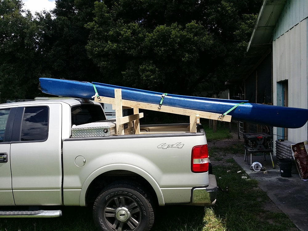 How far can a kayak hang out of a truck